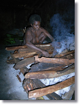 Late chief's wife Irene prepare fire for their dinner